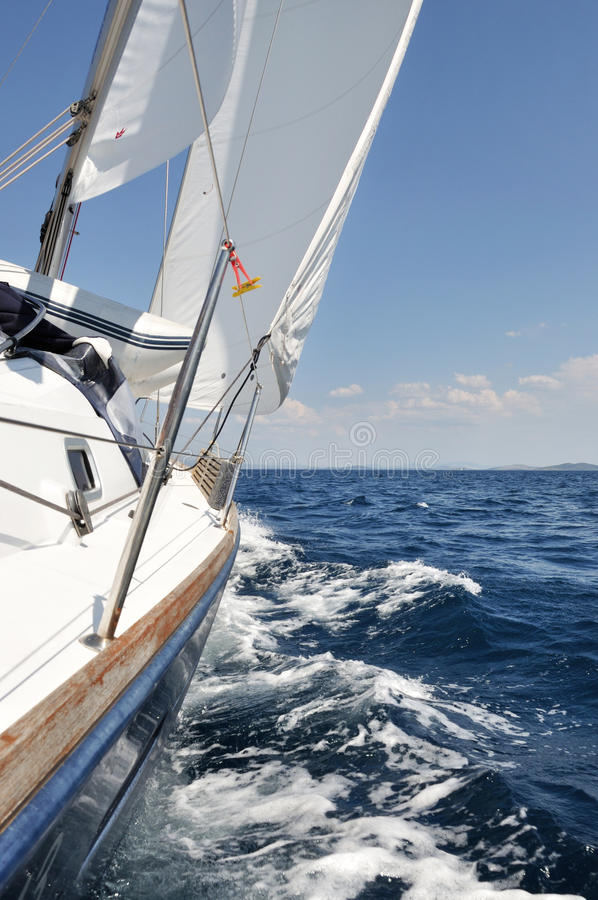 Sailing. With sailboat on open sea royalty free stock photos
