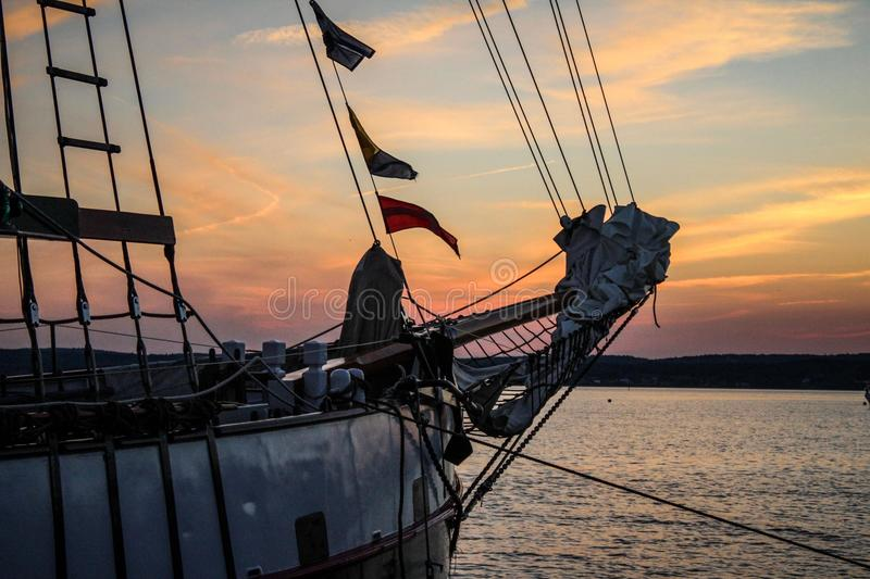 Sailing schooner at sunset stock images
