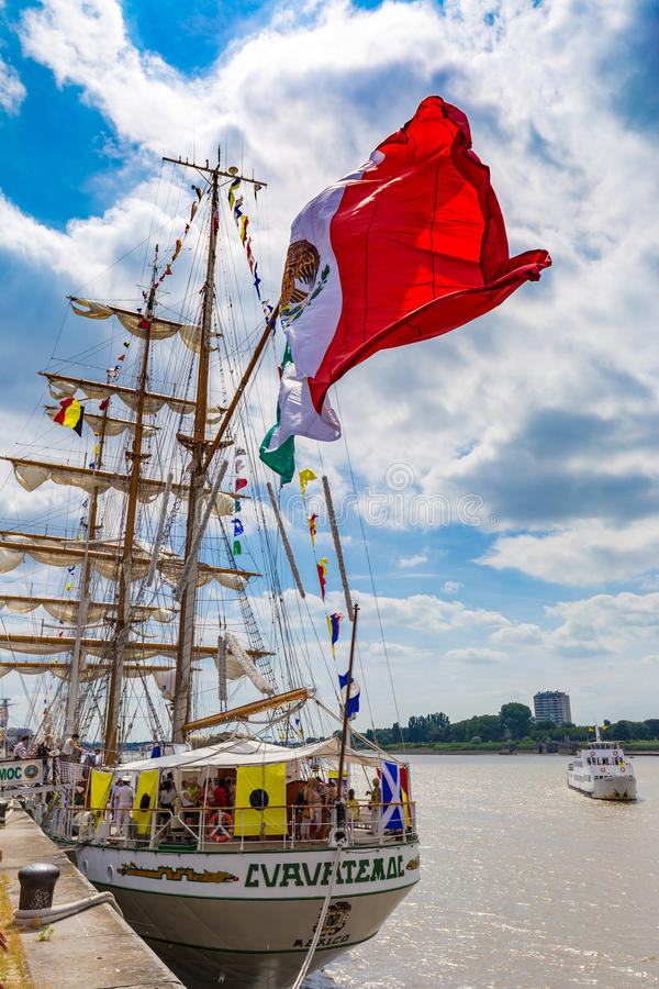 Sailing ship Cuauhtemoc seen wth huge waving Mexican flag in Antwerp during the Tall Ships Races 2016 event.  stock photography