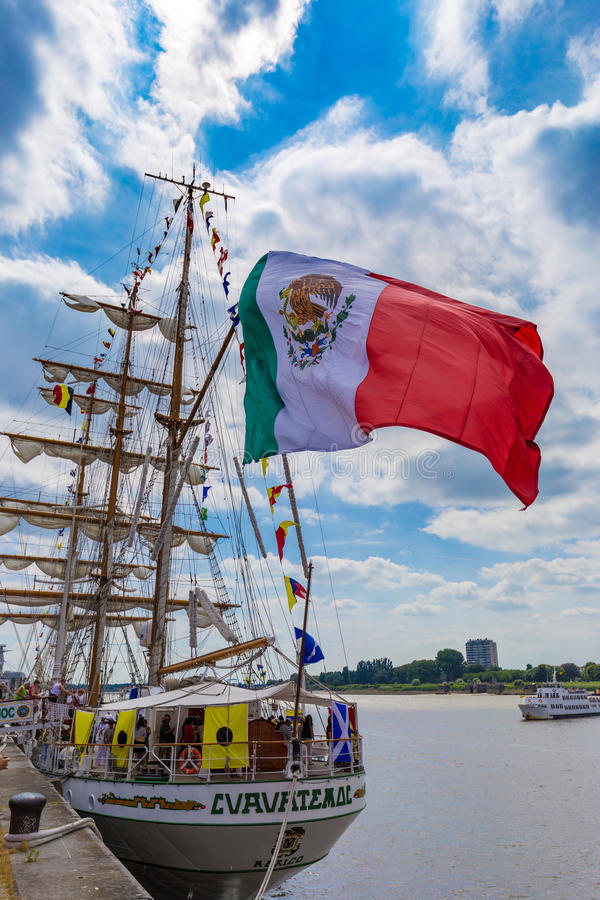 Sailing ship Cuauhtemoc seen wth huge waving Mexican flag in Antwerp during the Tall Ships Races 2016 event.  stock images