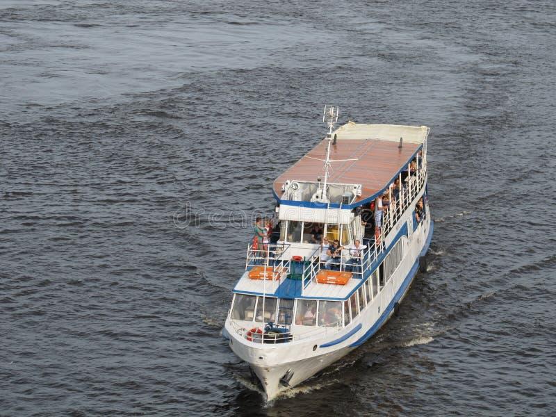 Sailing ship with happy people. Dnepr river, Kiev, Ukraine stock photo