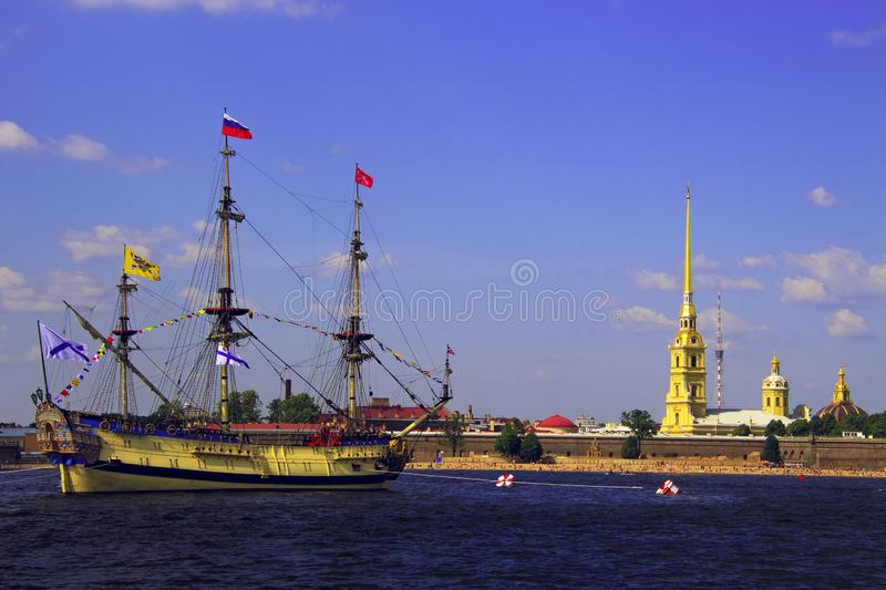 Sailing ship on the river opposite the fortress stock photos