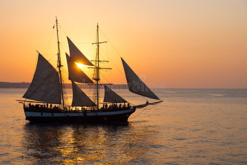 Sailing ship at sunset royalty free stock images