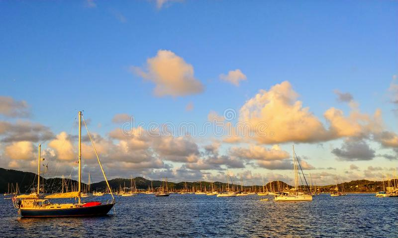 Sailing ship in the sunset light in St-Anne harbor, Martinique, Archipelago of the West Indies stock image