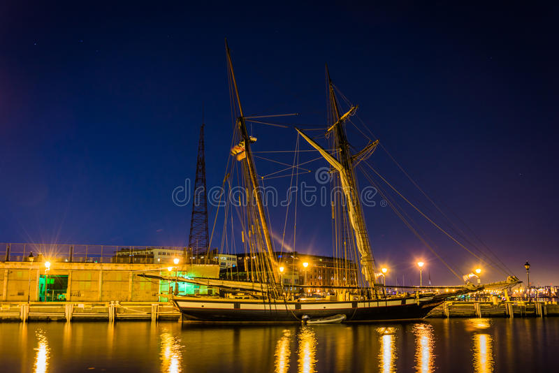 Sailing ship on the waterfront in Fells Point at night, Baltimore, Maryland. stock images