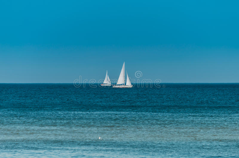 Sailing. Ship yachts with white sails in the open sea.  stock photos