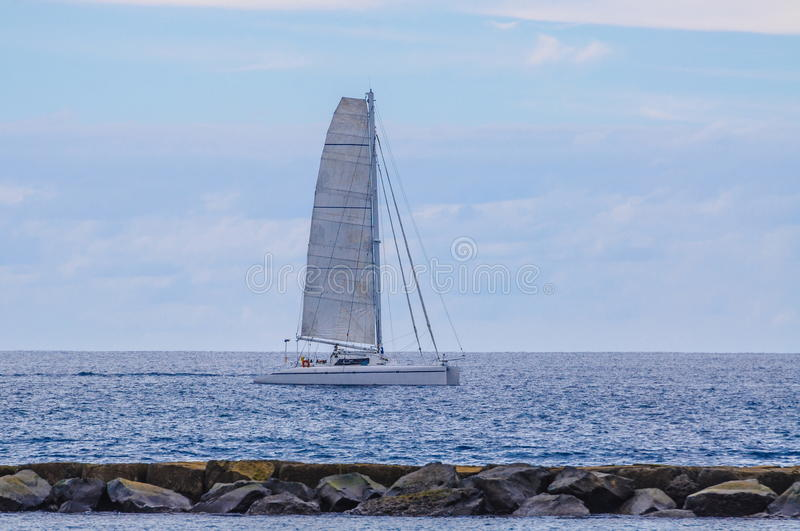 Sailing ship yachts with white sails in the open Sea. Luxury boa royalty free stock images