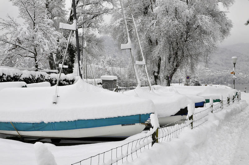 Sailing ships. Deeply snowcovered sailing ships in the city of Thun royalty free stock photography