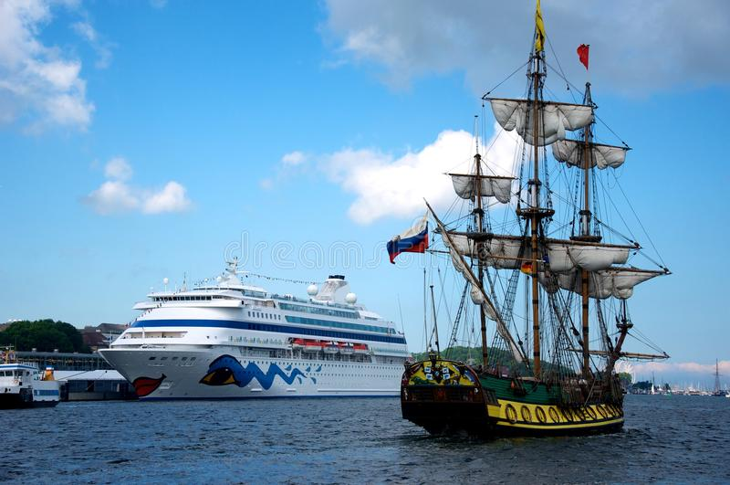 Sailing ships and cruise liner stock image