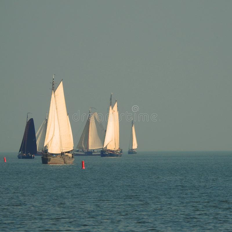 Sailing ships on the lake crossing between Volendam and Marken in the Netherlands stock image