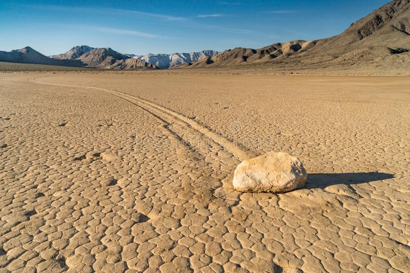 Sailing stone on The Racetrack Playa in Death Valley. The Racetrack Playa is a scenic dry lake located above the northwestern side of Death Valley, in Death royalty free stock image