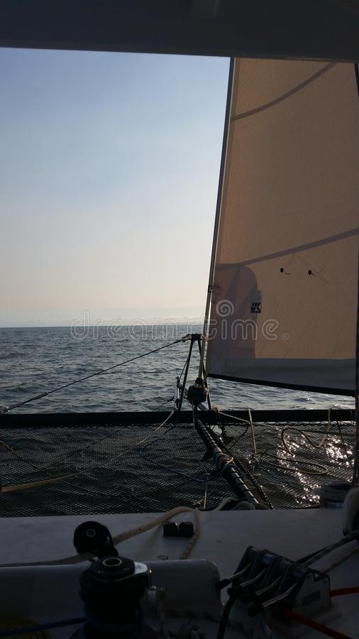 Sailing at sunrise royalty free stock images