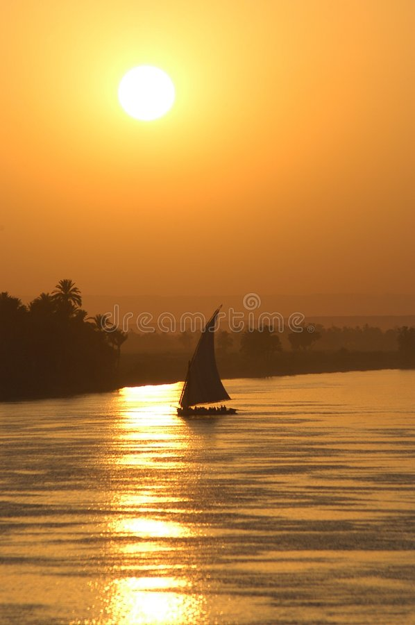 Sailing sunset stock image