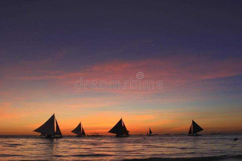 Download Sailing in sunset stock photo. Image of twilight, team - 20603204