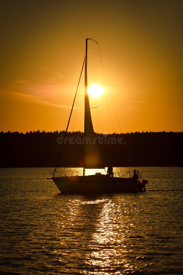 Sailing and sunset royalty free stock photos