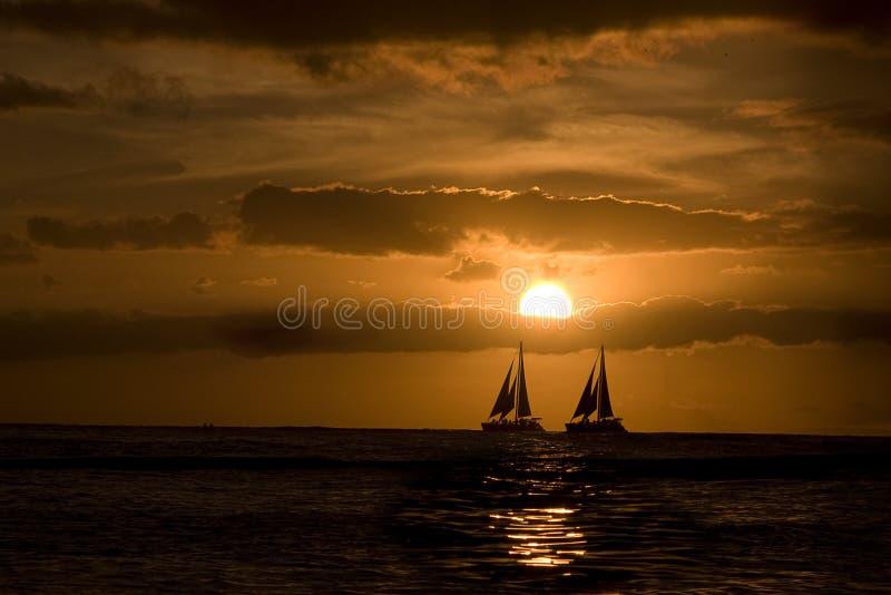 Sailing at sunset. royalty free stock image