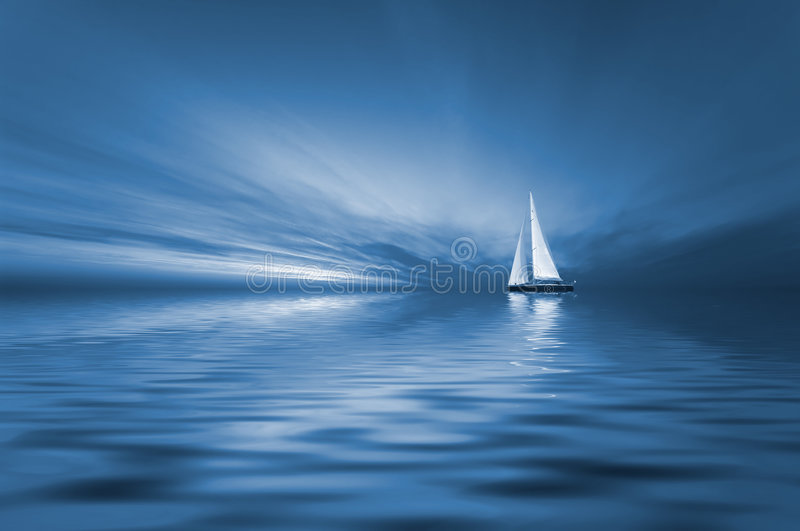 Sailing and sunset royalty free stock image