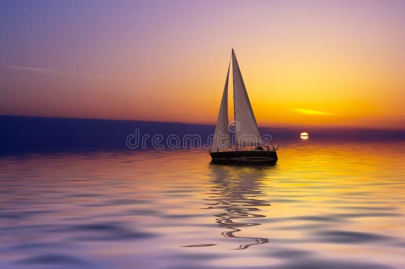 Sailing at sunset royalty free stock photography