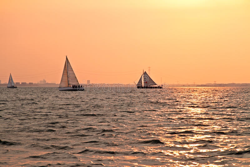Sailing at sunset on the IJsselmeer in Netherlands royalty free stock photos