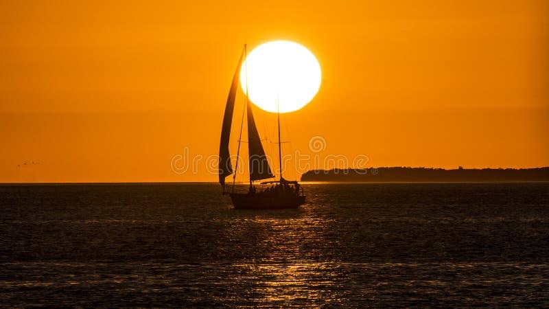 Sailing at Sunset royalty free stock image