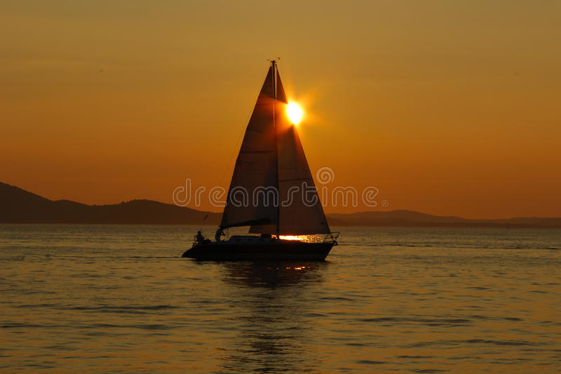 Sailing into the sunset royalty free stock photography