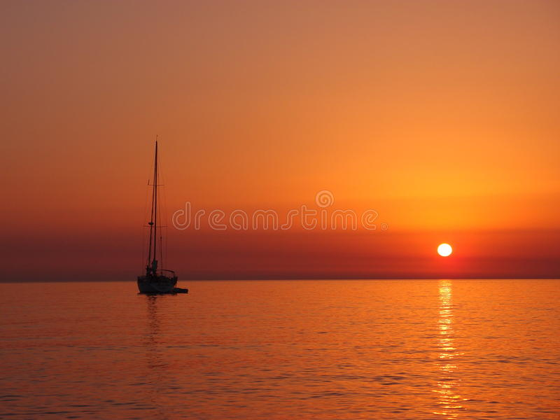Sailing before sunset royalty free stock photo