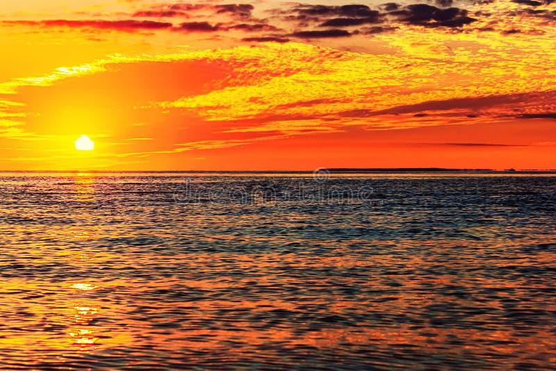 SAILING AT SUNSET TROPICAL ISLAND stock photo
