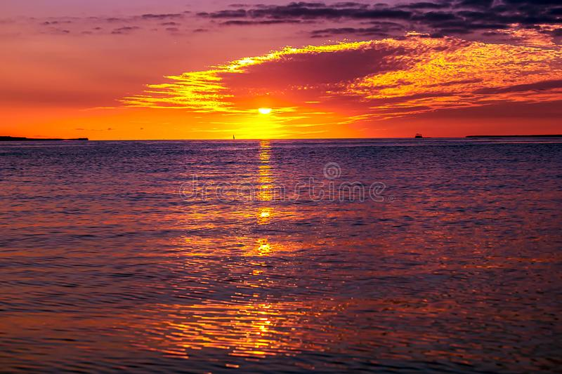 SAILING AT SUNSET TROPICAL ISLAND royalty free stock images
