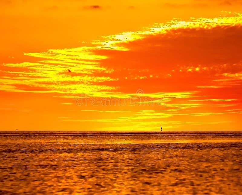 SAILING AT SUNSET TROPICAL ISLAND stock images