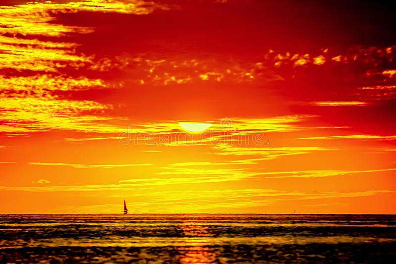SAILING AT SUNSET TROPICAL ISLAND stock image