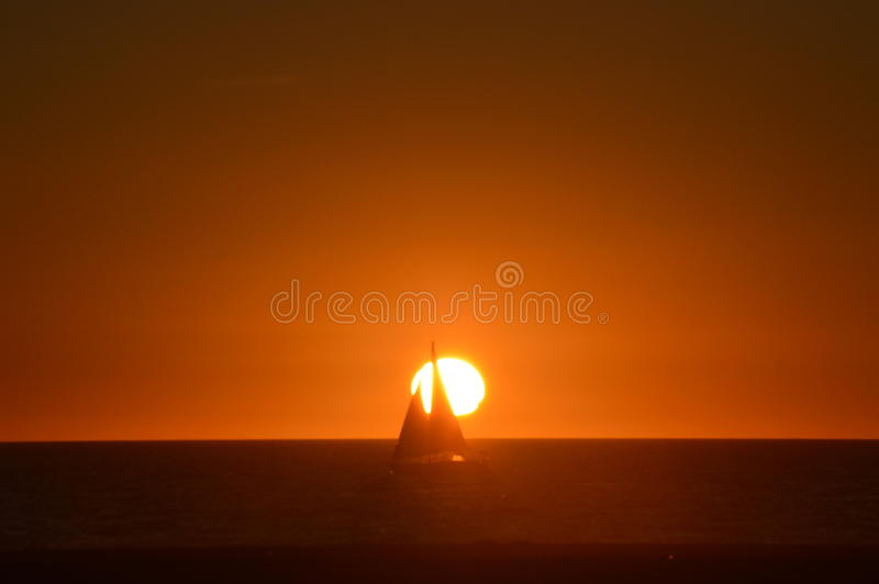 Sailing throught the sunset royalty free stock photo