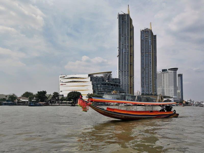 Sailing to Bangkok. A passenger boat sailing on the waters in Bangkok, Thailand royalty free stock photos