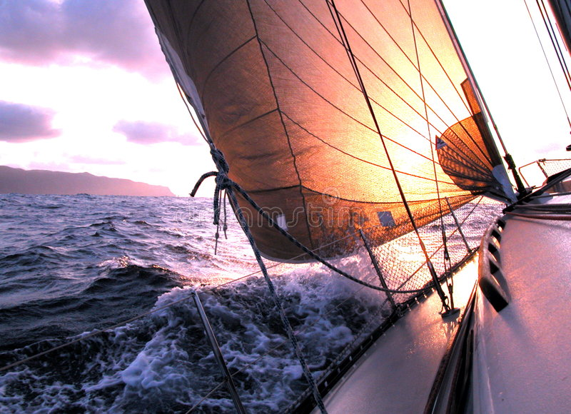 Sailing to the sunrise royalty free stock images