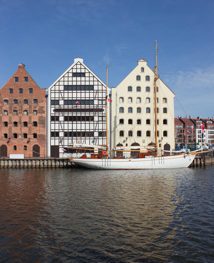 Download Sailing Vessel And Old Town Houses Over Motlawa River In Gdansk, Stock Photo - Image: 31296400