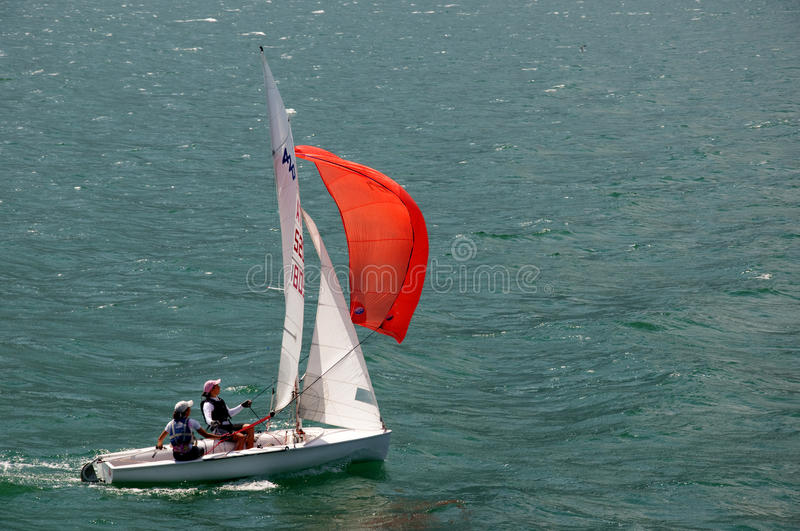 Sailing with the Wind. A small Sailing Boat on Lake Garda in Northern Italy. Lake Garda is known for its constant winds which mean sailing and windsurfing is royalty free stock image