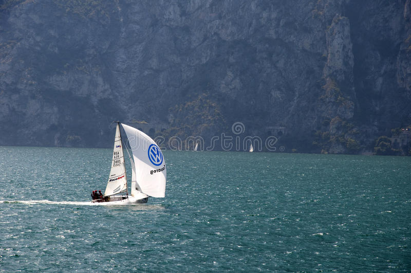 Sailing with the Wind. A small Sailing Boat on Lake Garda in Northern Italy. Lake Garda is known for its constant winds which mean sailing and windsurfing is royalty free stock photography