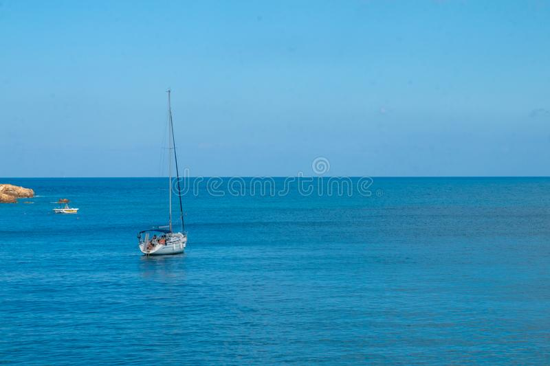 Sailing yacht in the blue sea. Ship yacht sails in the open Sea. Luxury boats. Crete, Greece. Aegean sea. Copy Space stock image