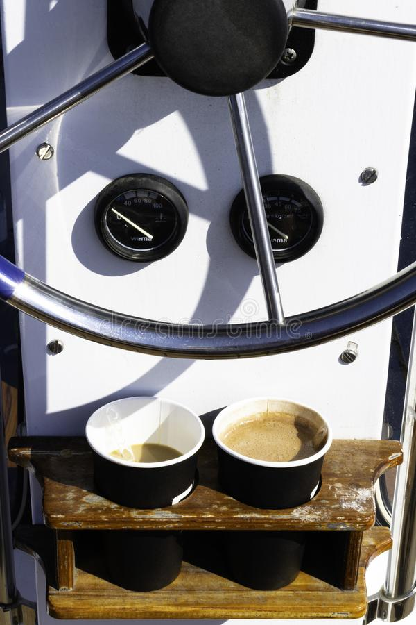 Sailing yacht control wheel and implement, helm, coffee royalty free stock photos