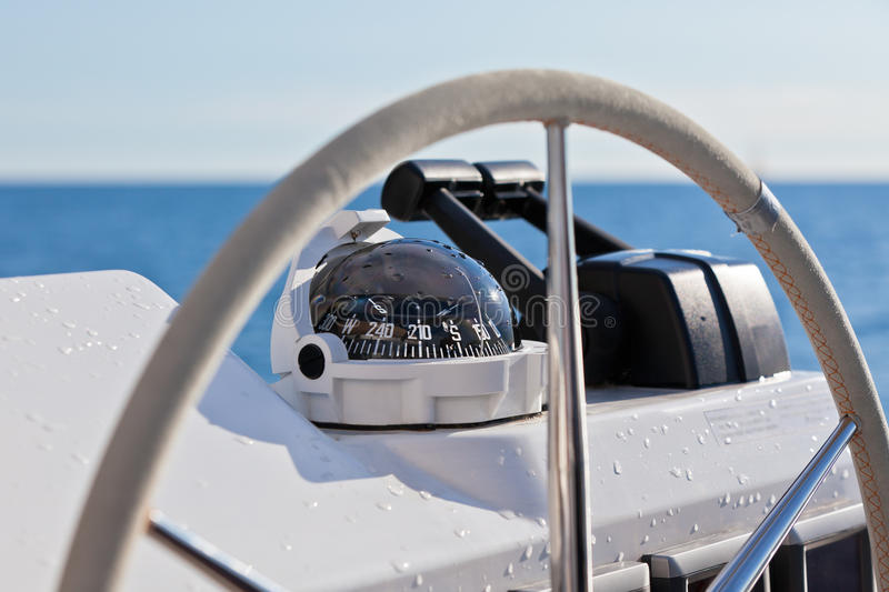 Sailing yacht control wheel and implement. Horizontal close up shot without people stock photography