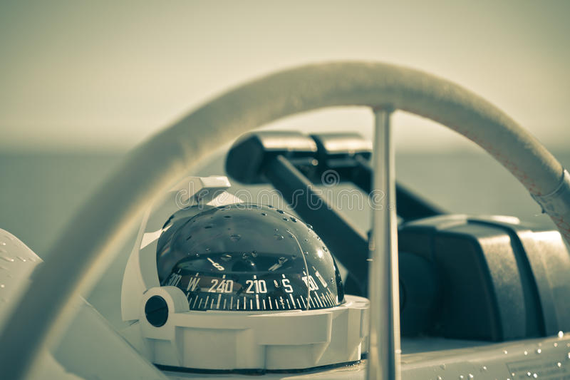 Sailing yacht control wheel and implement. Horizontal shot without people. Filtered stock photography