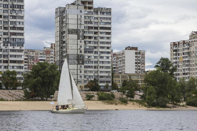 Sailing yacht on the Dnipro river in the sleeping district of Kyiv. Ukraine royalty free stock photo