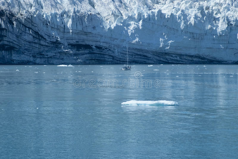 Sailing yacht in front of the Margerie Glacier at Glacier Bay stock photography
