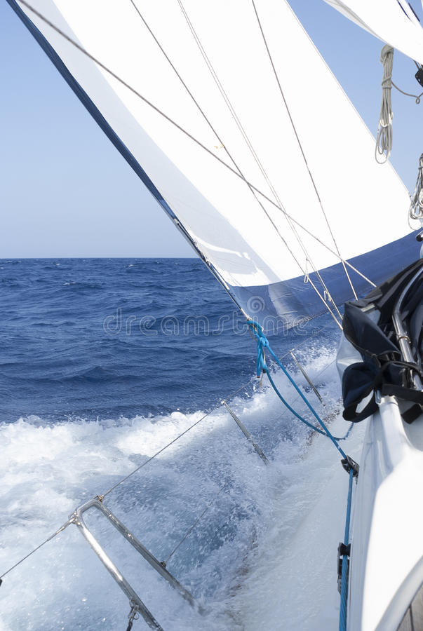 Sailing yacht full speed ahead. In clear blue sea stock images