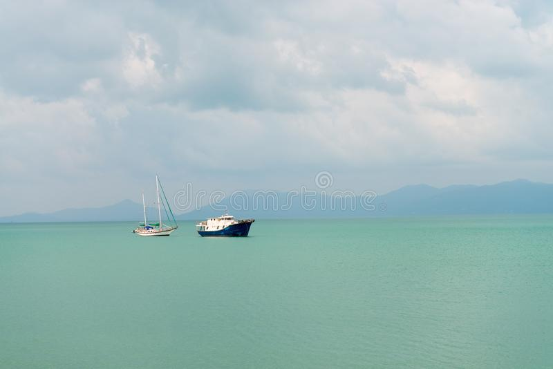 Download Sailing Yacht And Motor Boat In The Sea Stock Photo - Image of horizon, holiday: 106387412