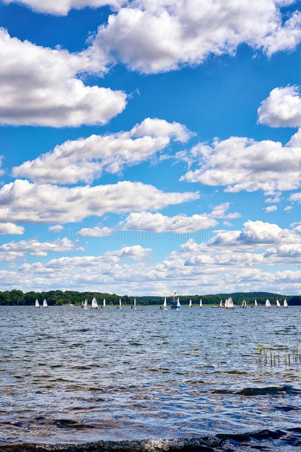Sailing yacht race under clouds at Schweriner See. Mecklenburg-Vorpommern, Germany stock photography