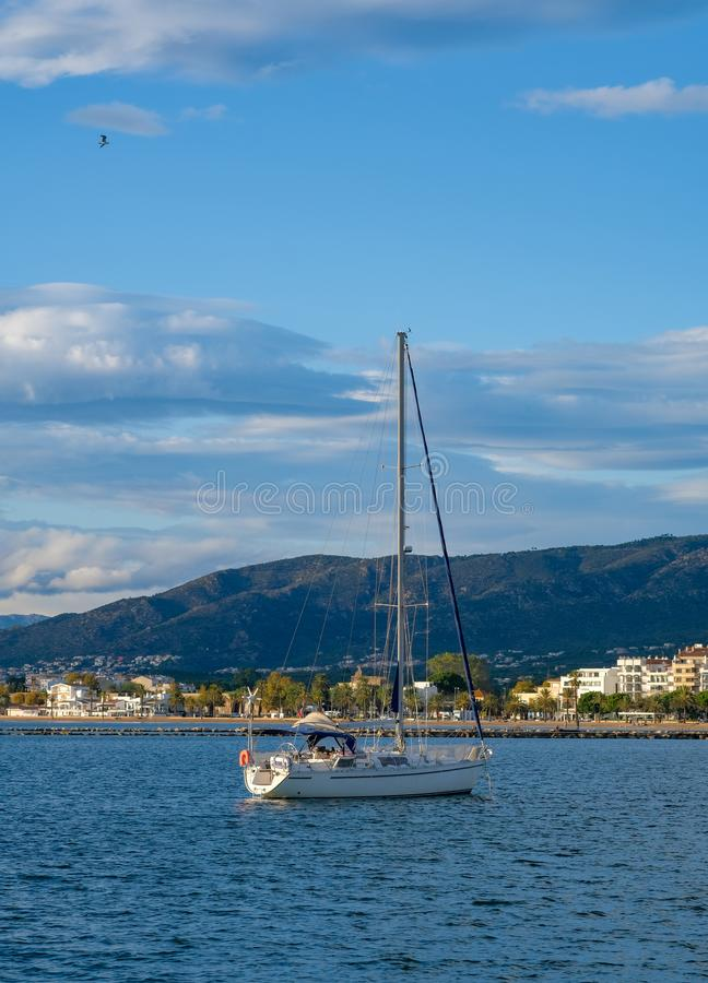 Sailing yacht, sailboat in the bay on city landscape background stock photos