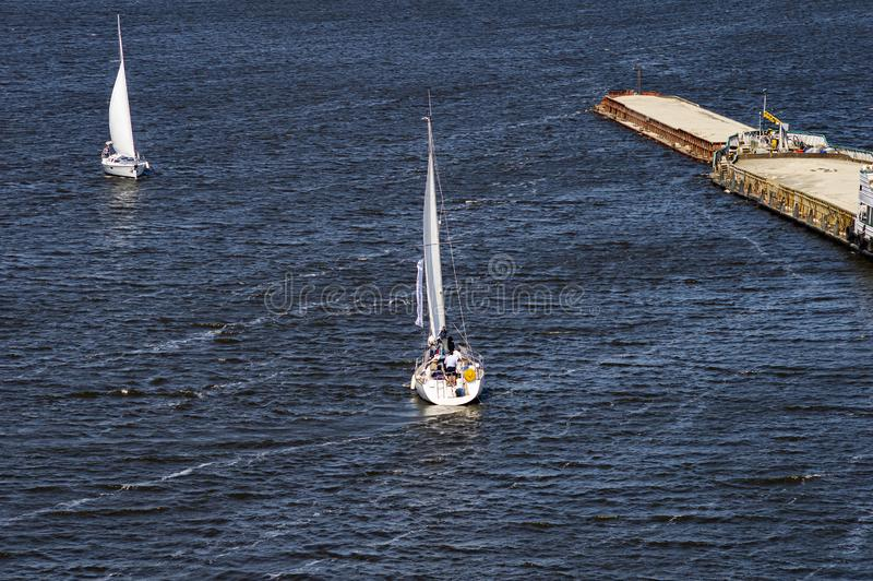 Sailing yacht sailing with an open white sail. Sports and recreation stock photography
