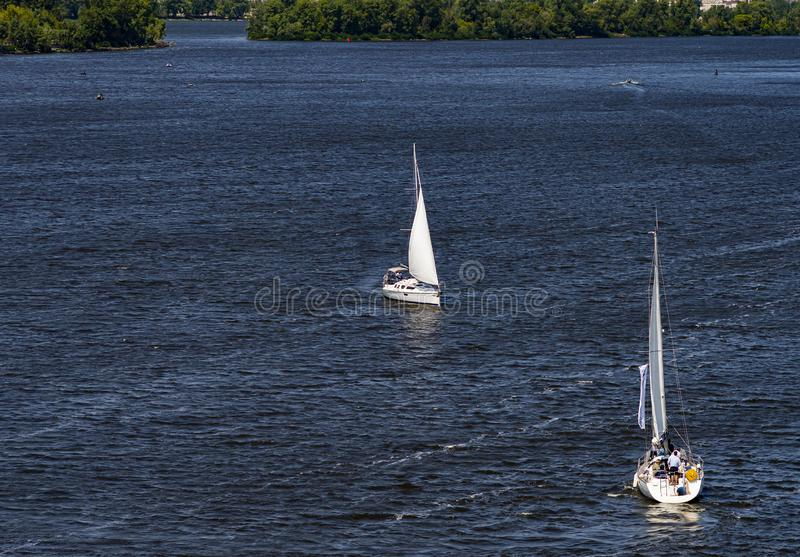 Sailing yacht sailing with an open white sail. Sports and recreation royalty free stock images