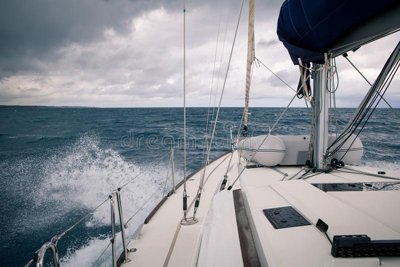 Sailing yacht during a storm, the view from the bow of the ship royalty free stock images
