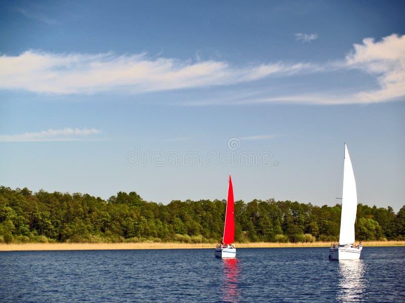 Sailing yachts on lake stock photo